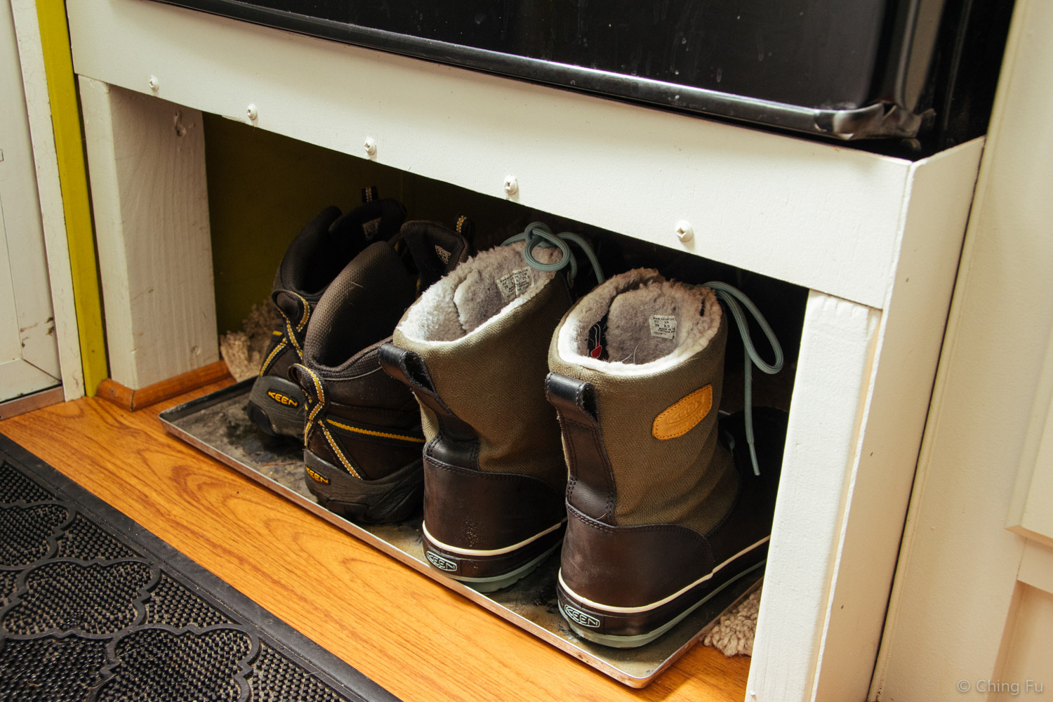 Our $1 baking sheet turned boot tray.