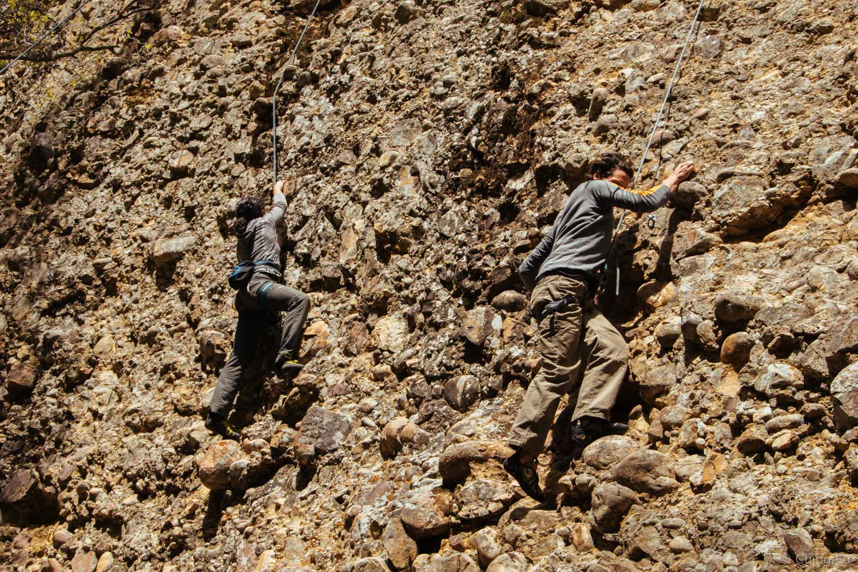 Aisha and Jerud climbing Billy the Kid wall.
