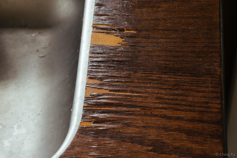 Wood veneer that's peeling from our plywood countertop.