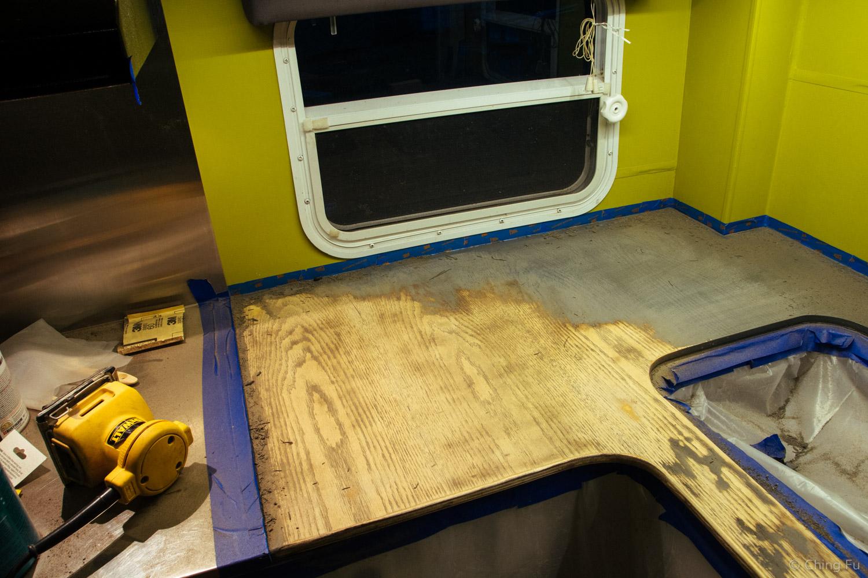 Late night kitchen countertop sanding.