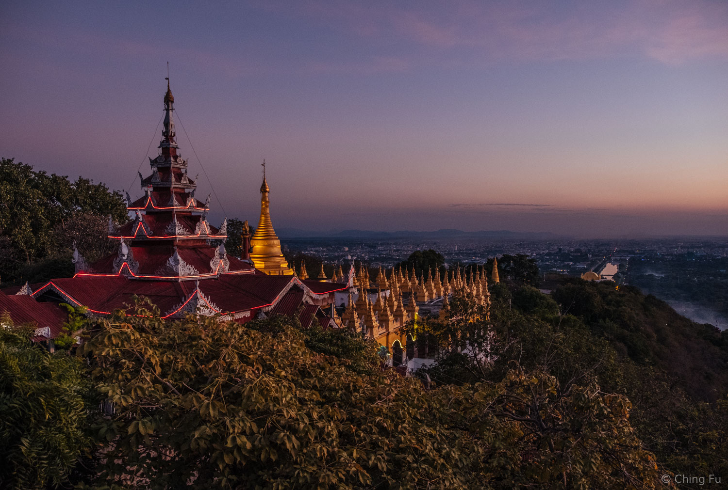View of the structure I walked through to get to the summit. Mandalay Palace's moat reflects the sunset in the background.