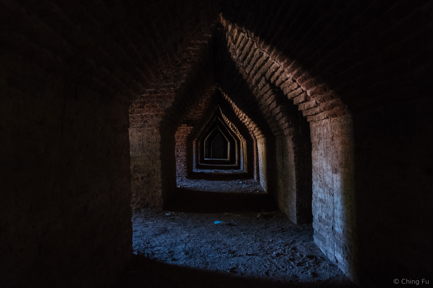 There were rows of corridors under Maha Aung Mye Bon Zan Monastery. Stray dogs expertly weaved their way through the dark openings.