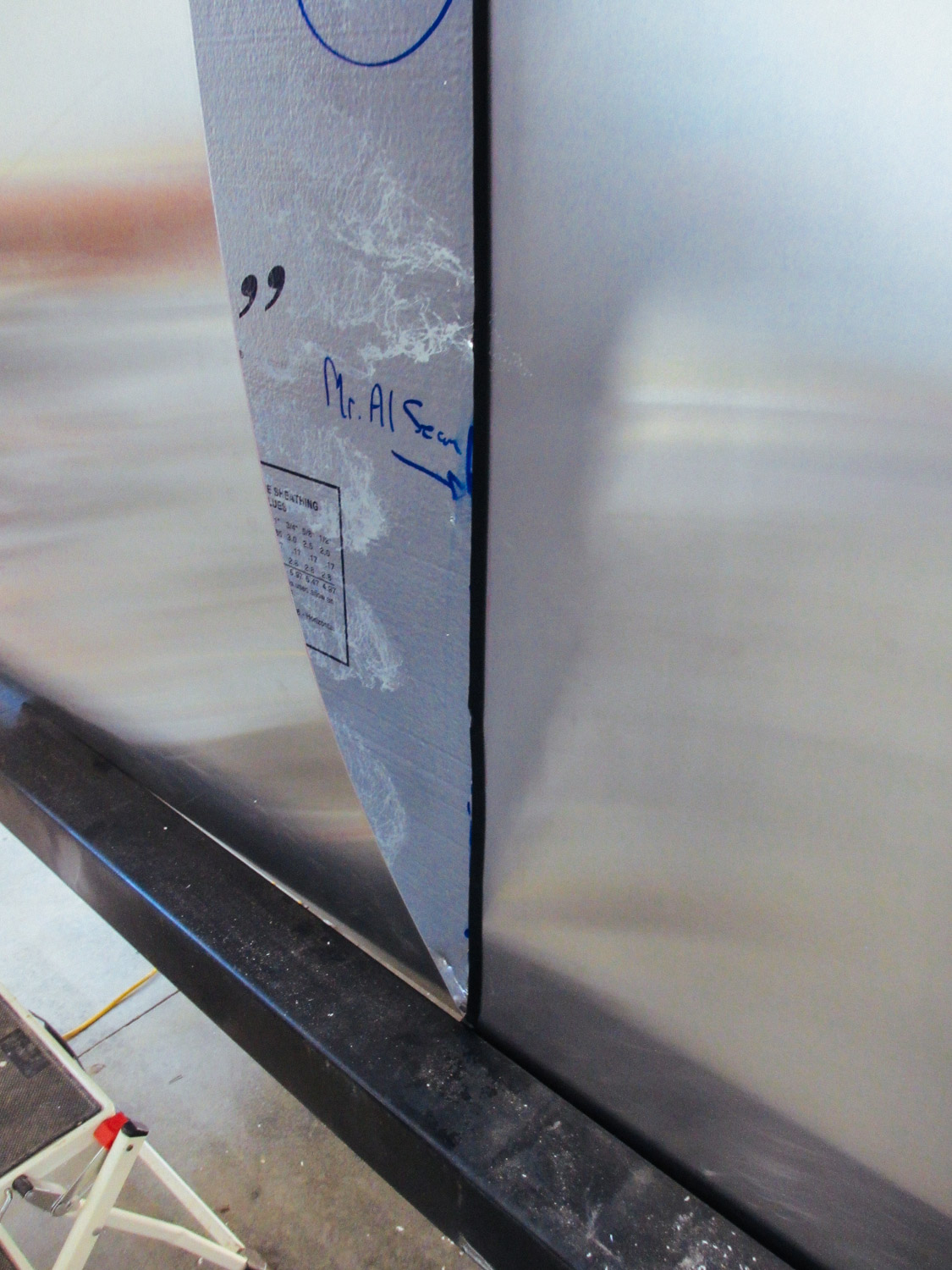 Butyl tape (the black stripe) was placed where the aluminum sheets overlapped each other. This not only kept the sheets stuck to one another, but more important, the butyl tape ensured the screw holes in the siding would be waterproof.