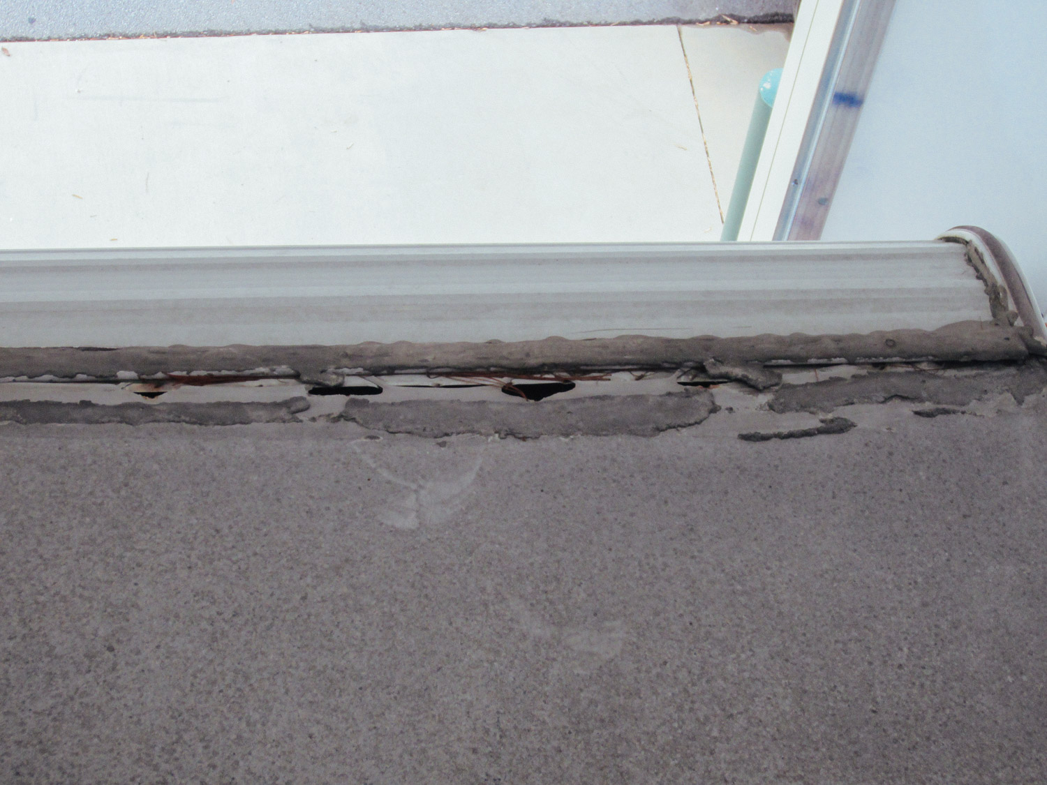 No wonder the roof was leaking! The seams were so old they were cracked.