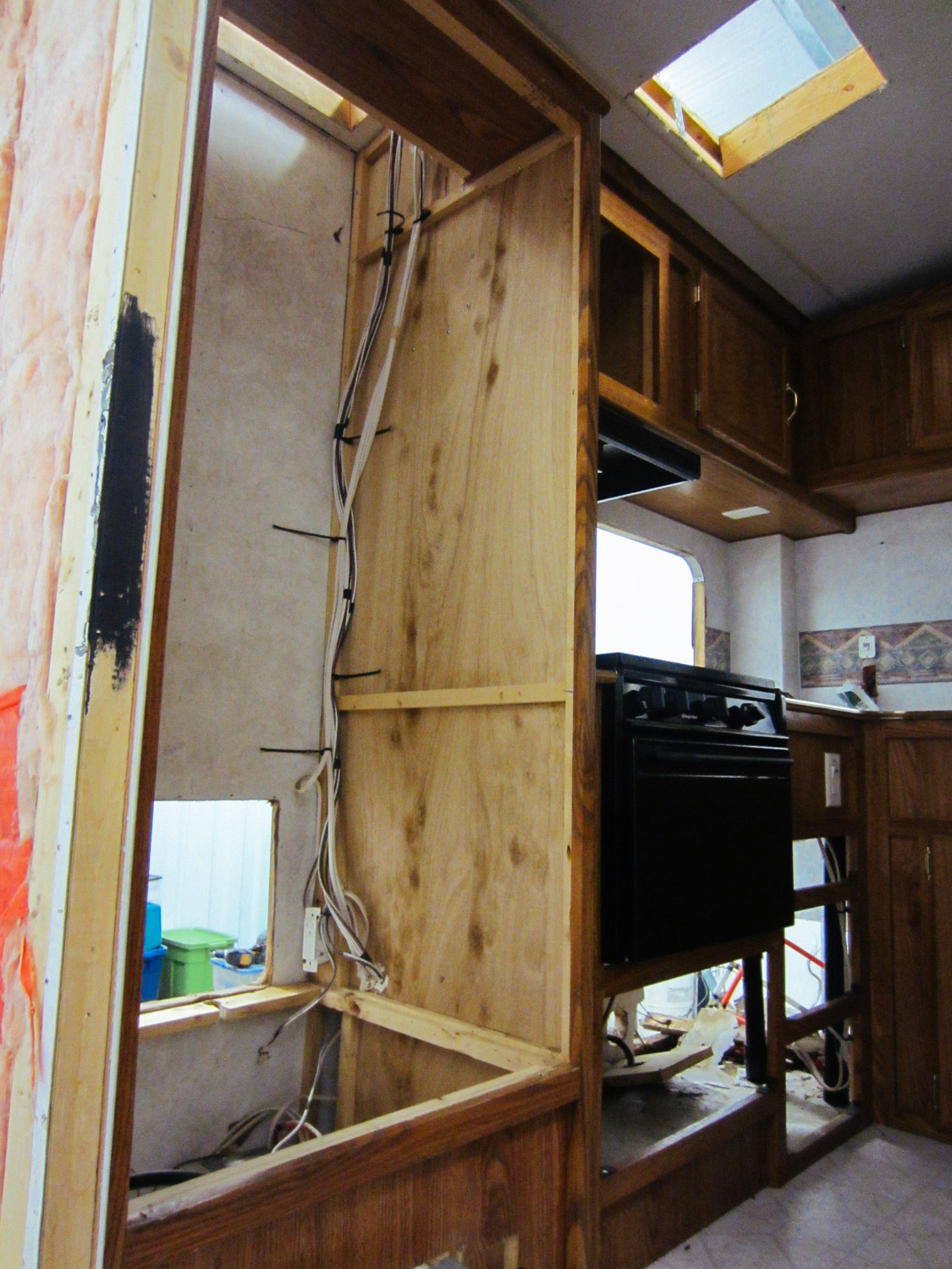 Since we were going to put in a residential fridge, we removed original cabinetry that held the RV fridge.