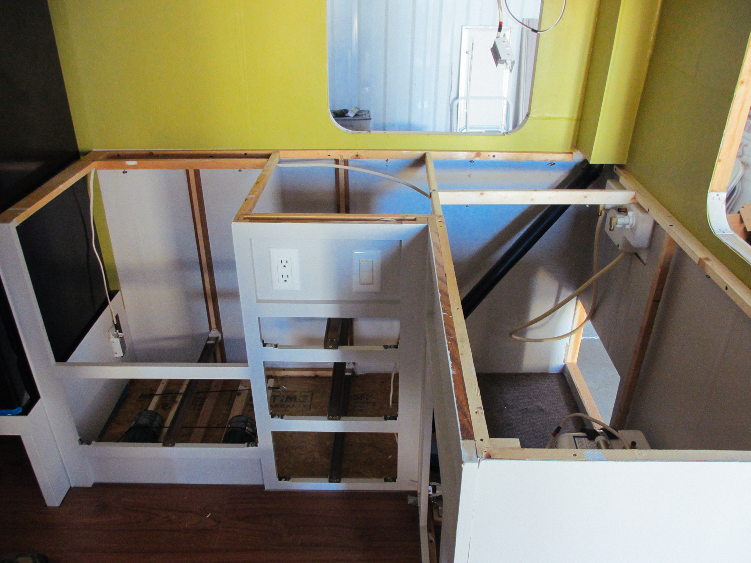 The main kitchen cabinets were reinstalled after being painted.