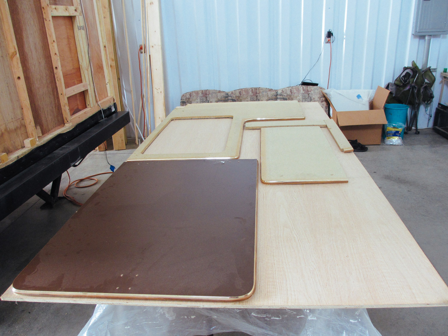 We traced the original kitchen countertop and flip-up on oak plywood to make new countertops.