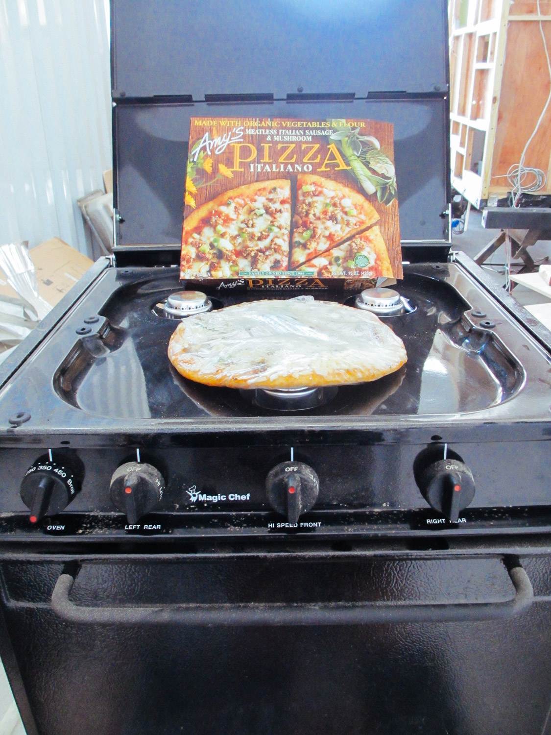 We made sure the RV stove/oven could actually run of camping propane fuel bottles by heating up a frozen pizza.