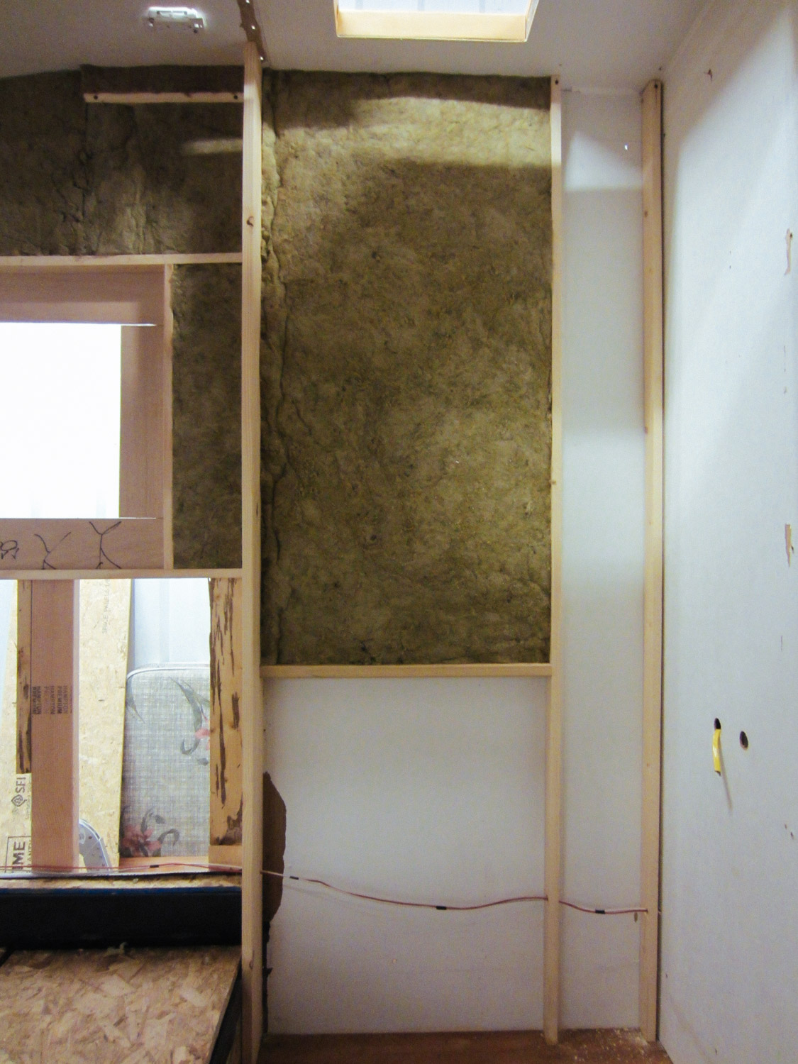 We added studs to the shower wall so we could insulate that space with mineral wool.
