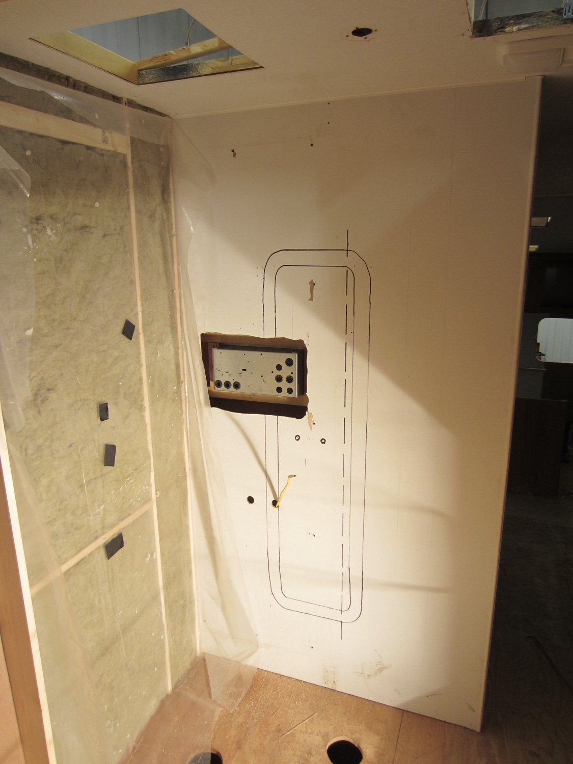 We moved the distribution panel from underneath the fridge to the wall between the shower and the toilet.