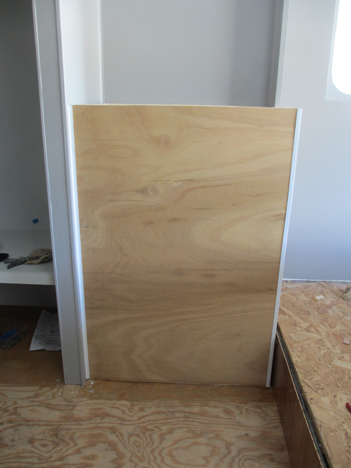 The bathroom cabinet with sides on.
