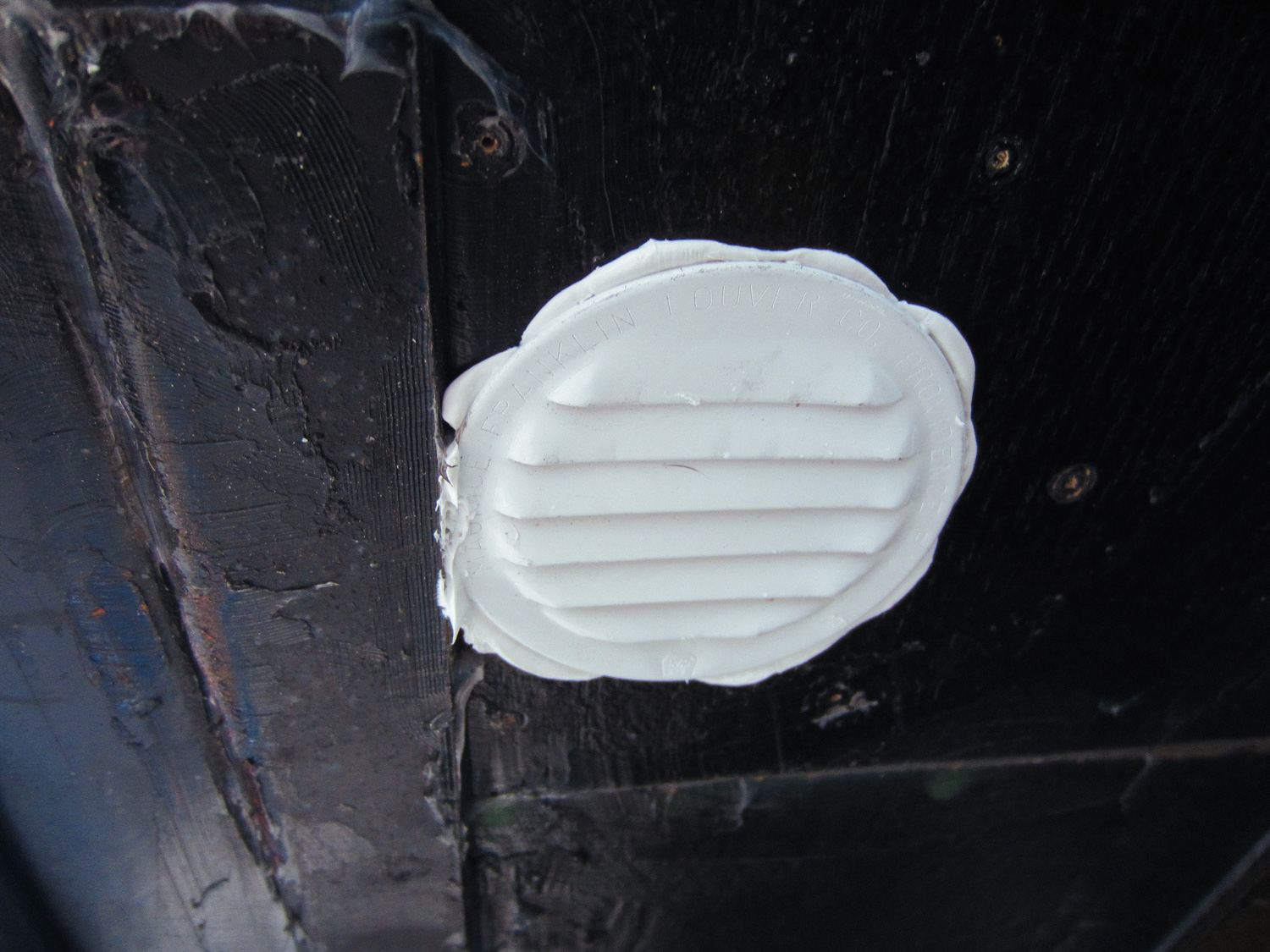 This is what the composting toilet vent cover looks like from underneath the RV. This has been recently (2018) changed and the toilet now vents out the roof.