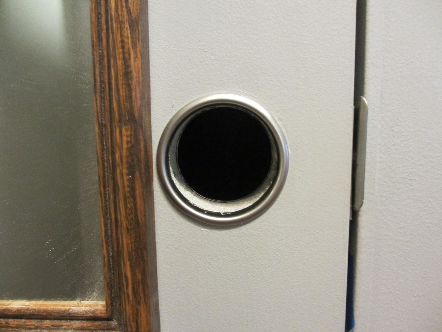 """We decided to not install a standard doorknob on our closet door. Instead we have a """"finger hole"""". This opens up the space in the hallway."""