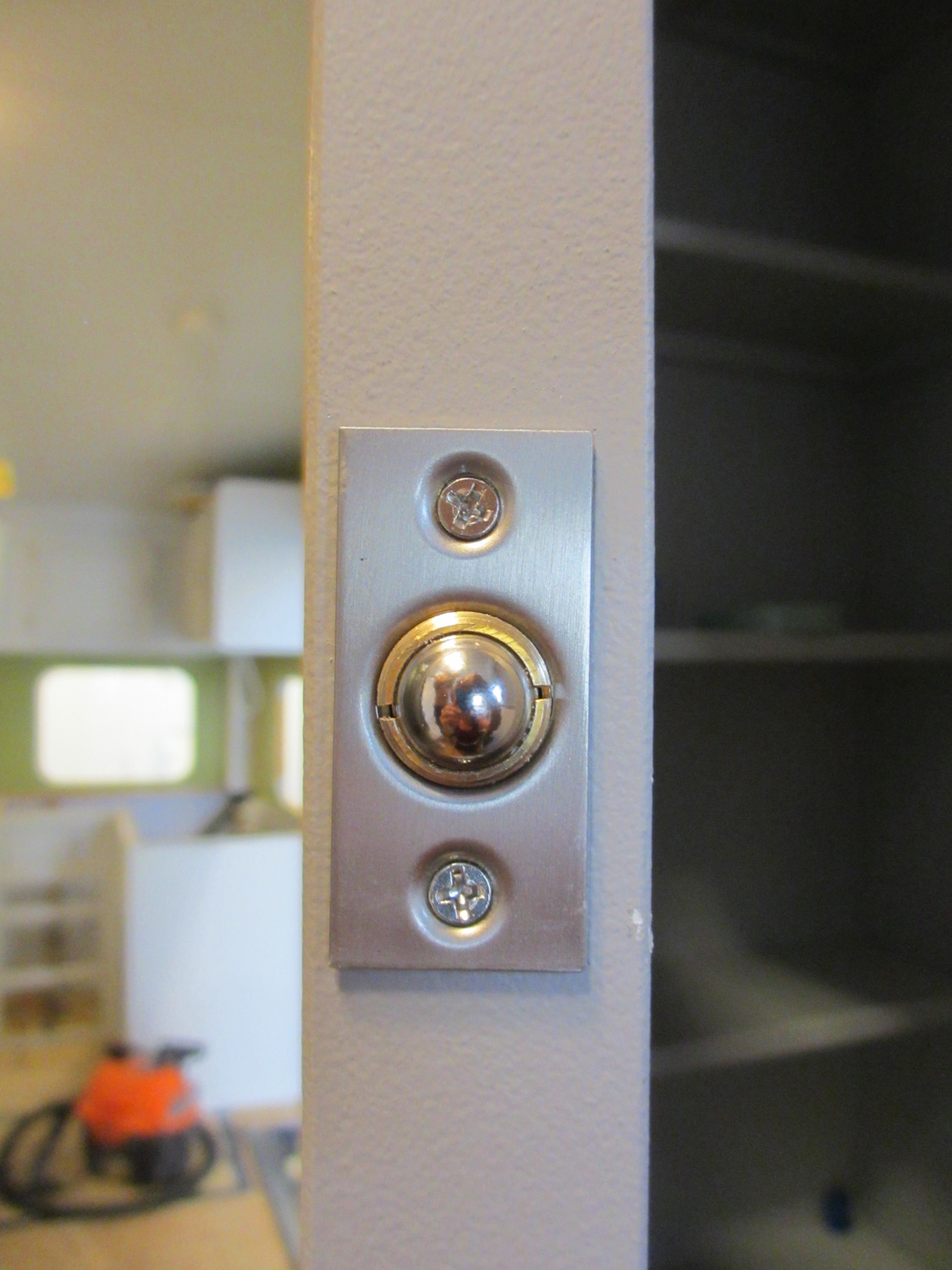 """This """"finger hole"""" uses a spring latch to keep the closet door shut."""