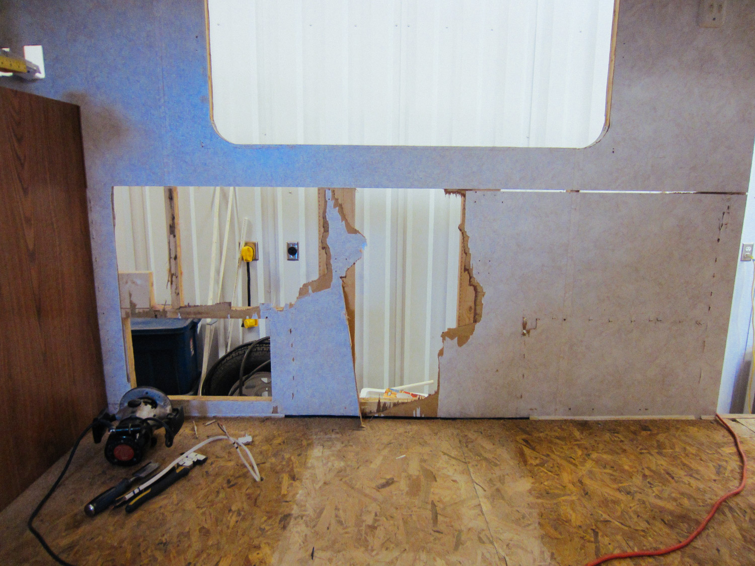 We had to remove the dinette set so we could paint it, but didn't realize how much damage it would cause to the wall.