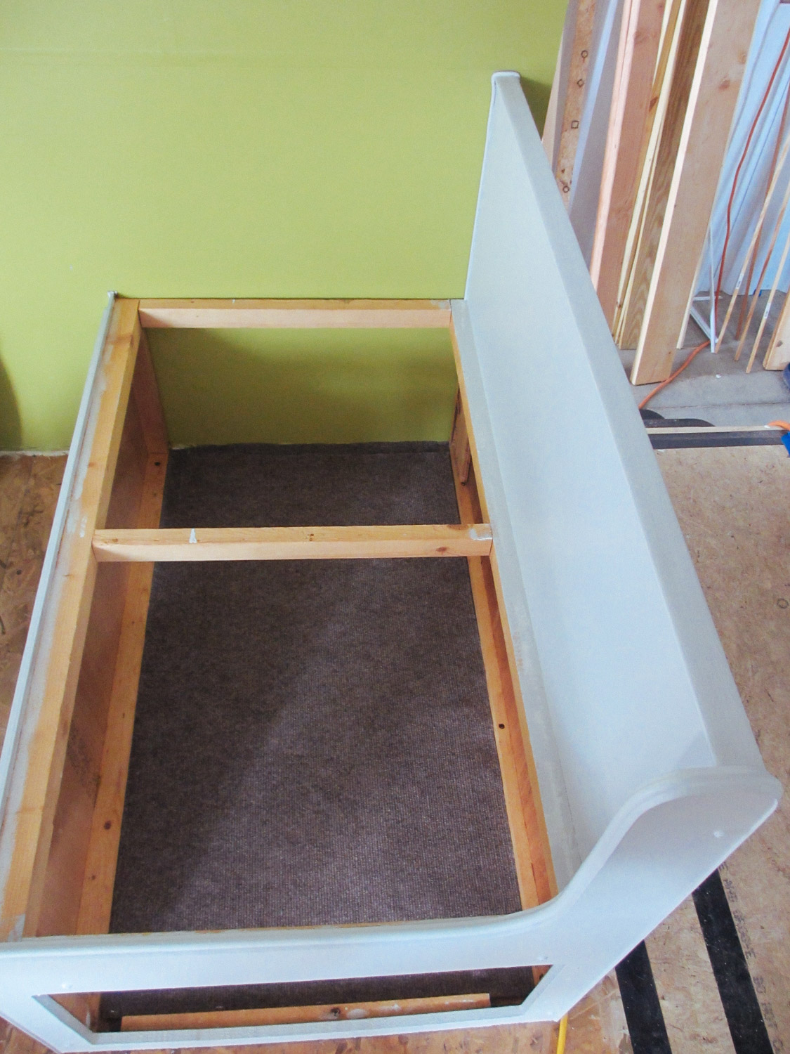 We added pieces of carpet in the dinette seat storage area.