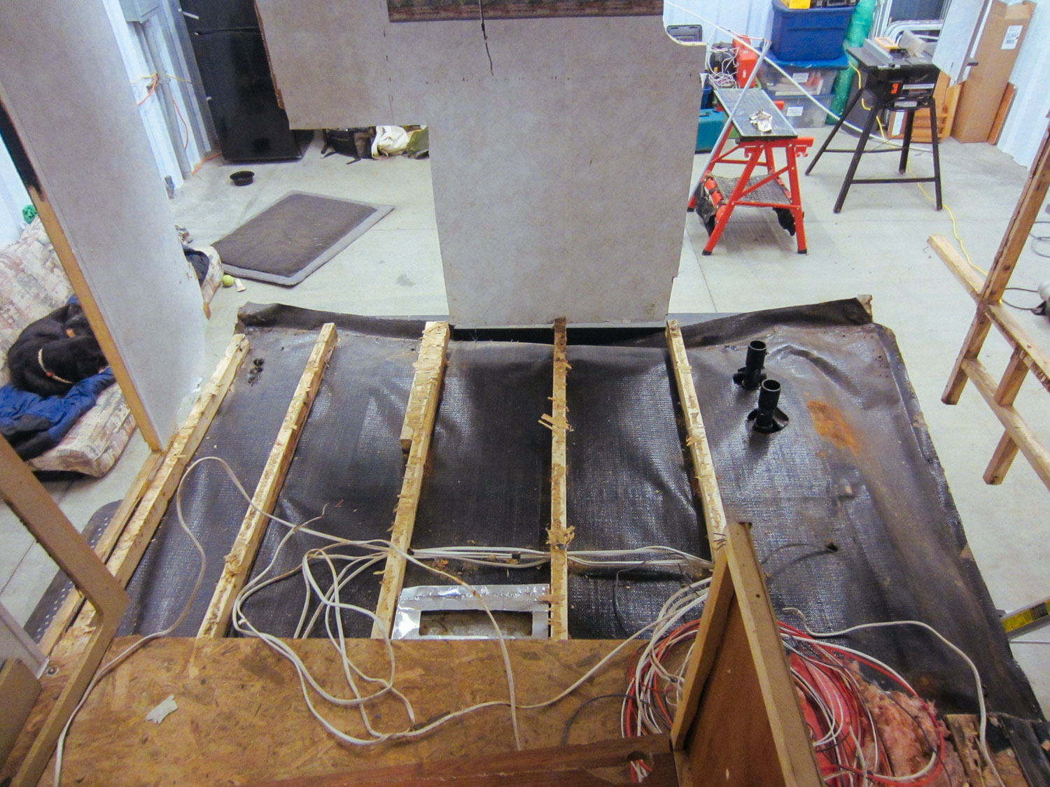 The kitchen sub-floor had to be ripped out due to water damage.