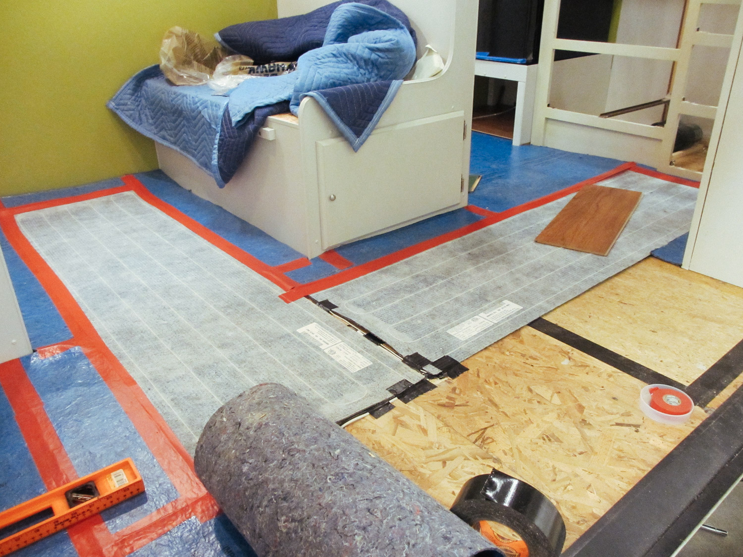 We placed floor heating pads between the dinette seats and in the kitchen area instead of underlayment.