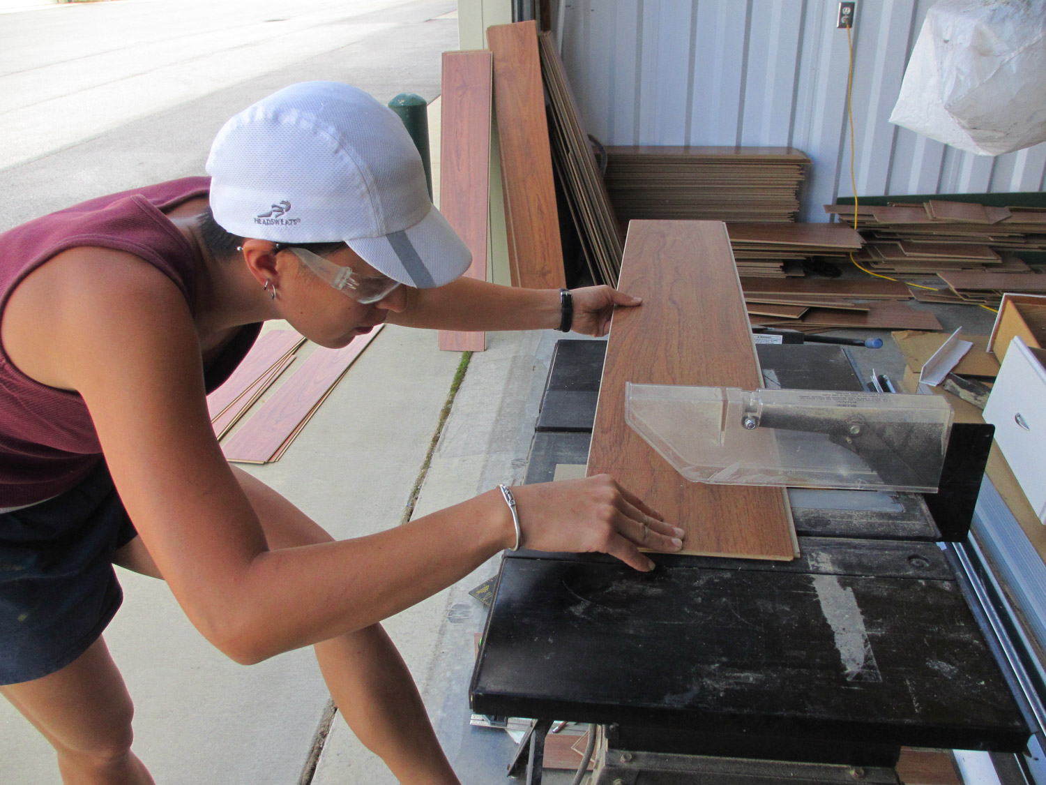 The table saw was used to cut laminate floor pieces to length. Our table saw was extremely ghetto and we're so lucky to still have all of our fingers.