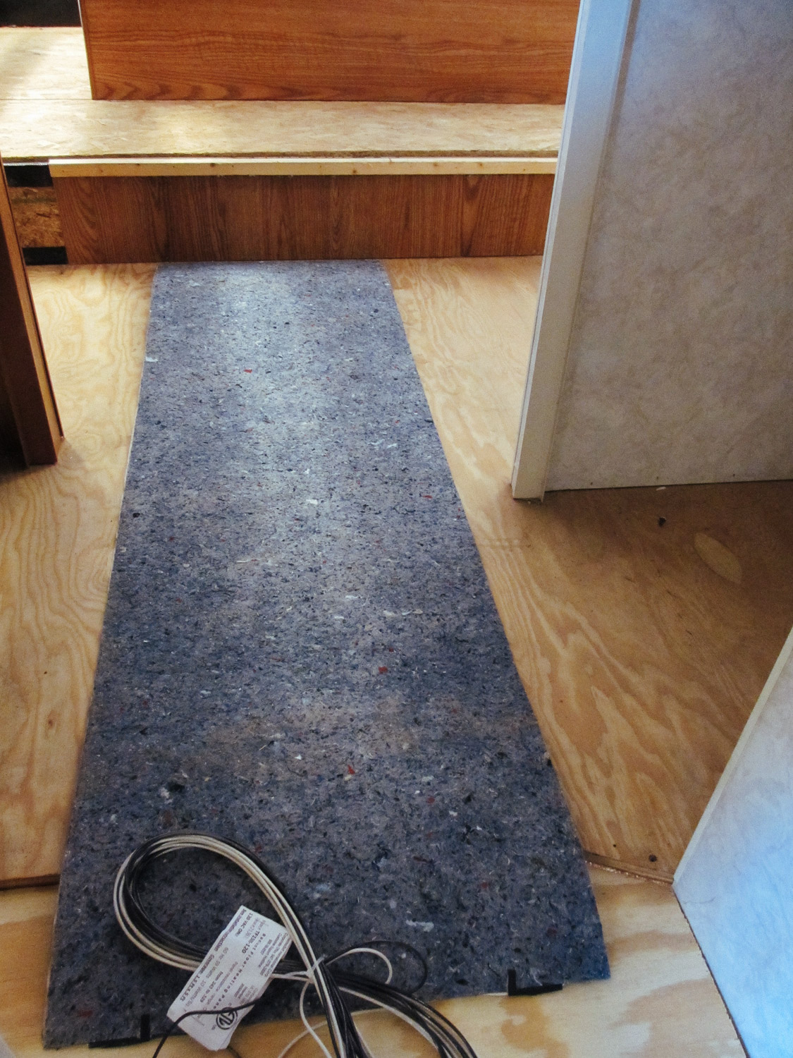 We had to extend the floor in the bedroom/bathroom hallway so it could fit a 5 ft. long piece of floor heating pad.