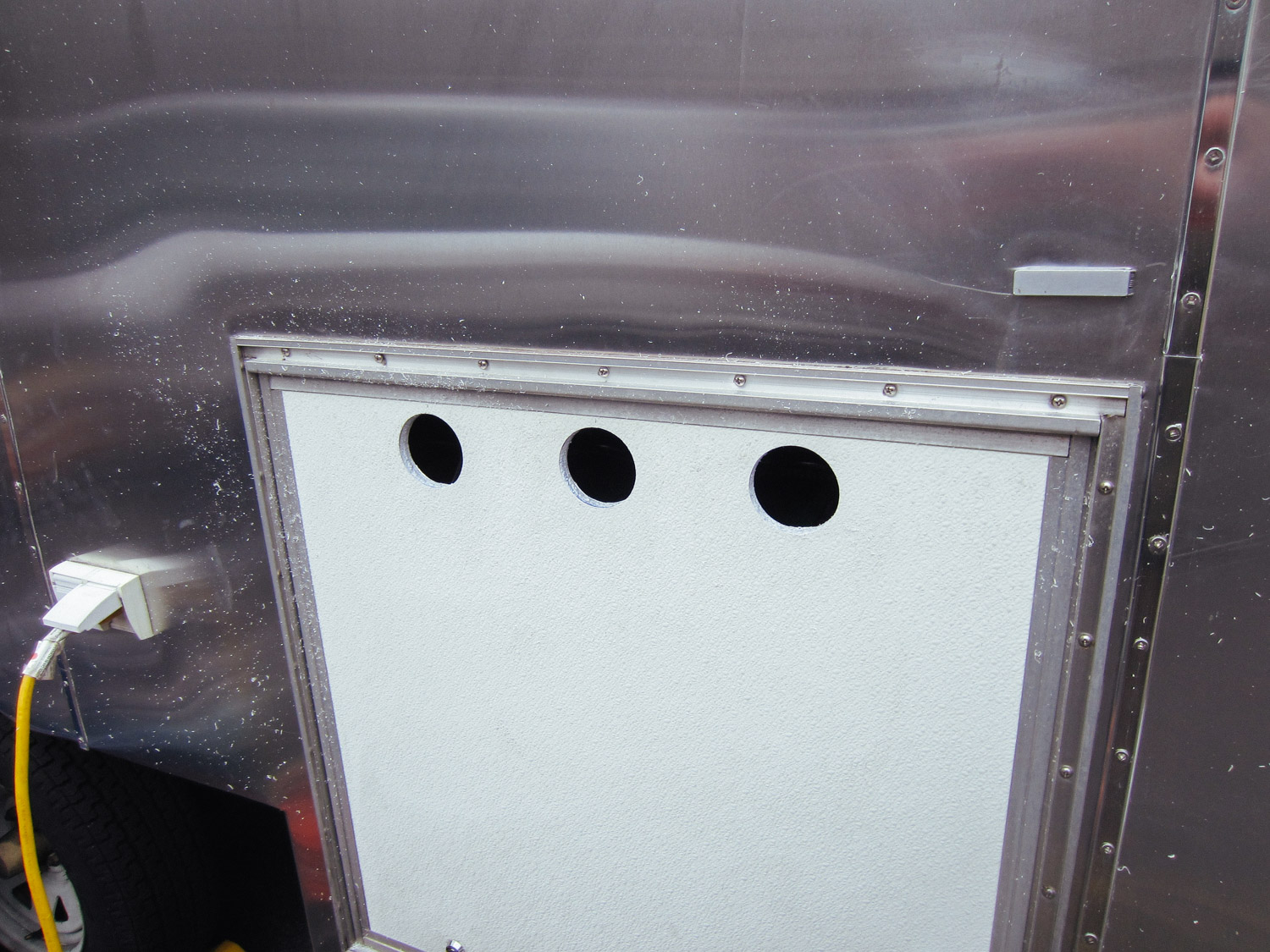 We drilled vent holes into the compartment door to keep the batteries cool and vent battery gases.