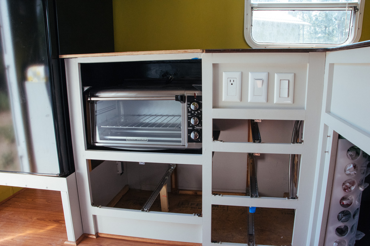 Our new electric oven is actually an extra large countertop toaster oven. We also use an induction countertop cooktop.