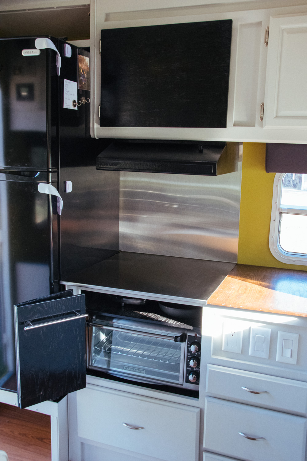 Our new kitchen! The induction cooktop is stored in the shelf above the toaster oven.