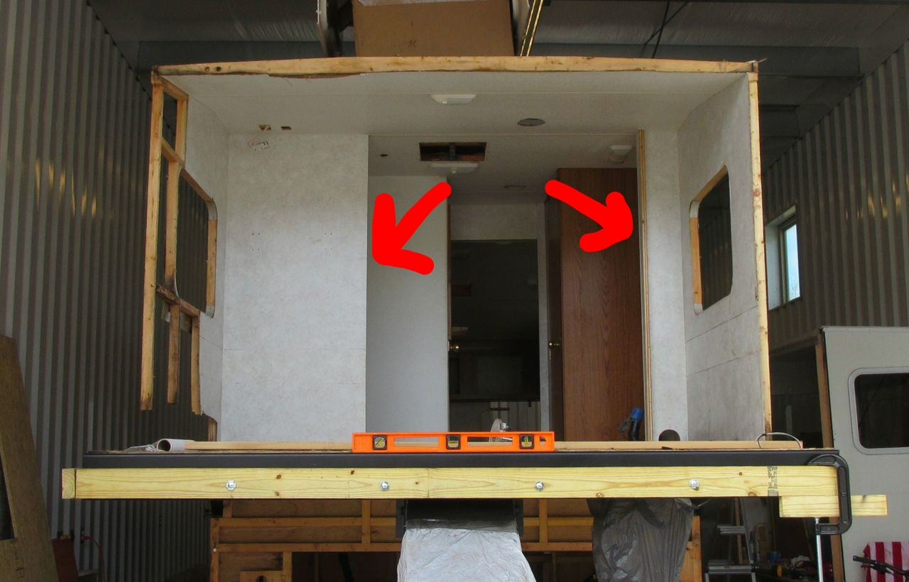 """Before: See the two wall the arrows are pointing at? The walls """"separated"""" the bedroom from the shower (on the left) and bathroom sink (on the right)."""