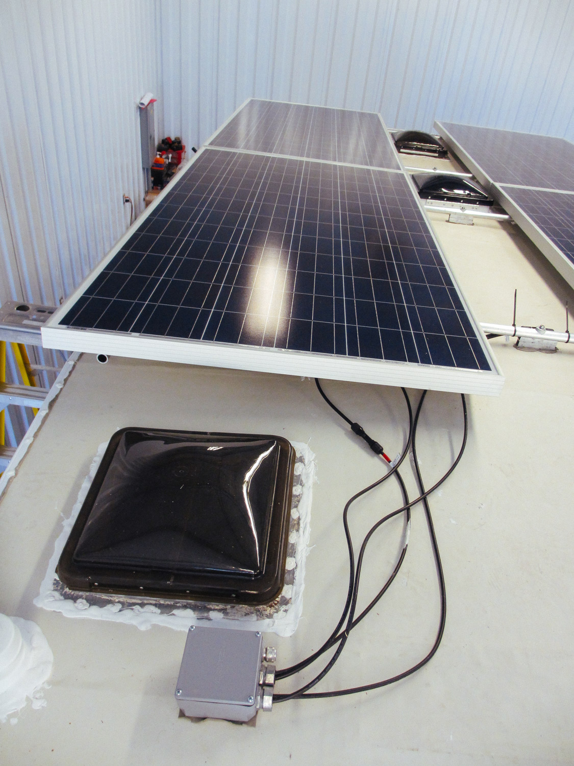 Solar panel leads going through the roof.
