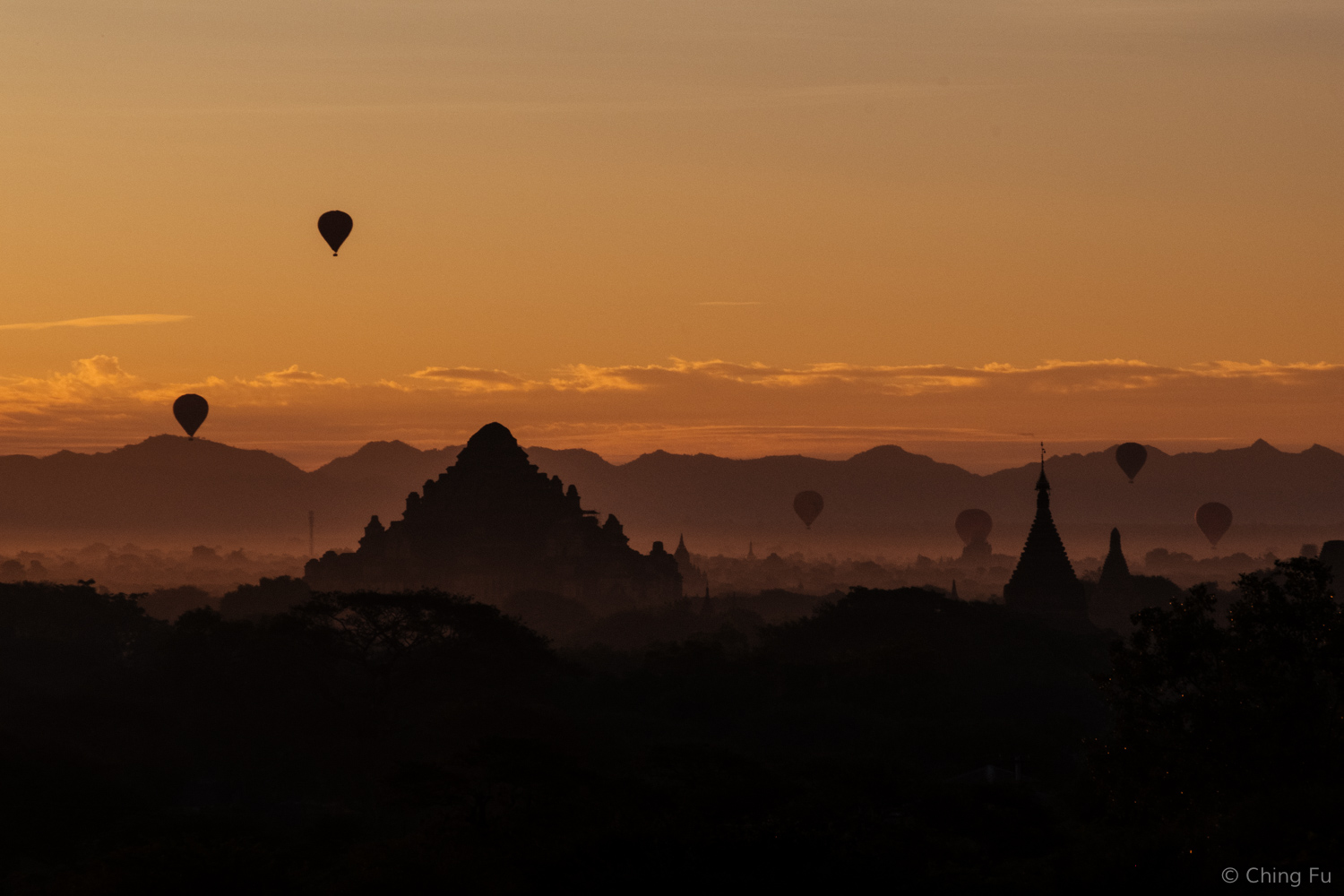 Sunrise and hot air balloons over Dhammayangyi Temple.