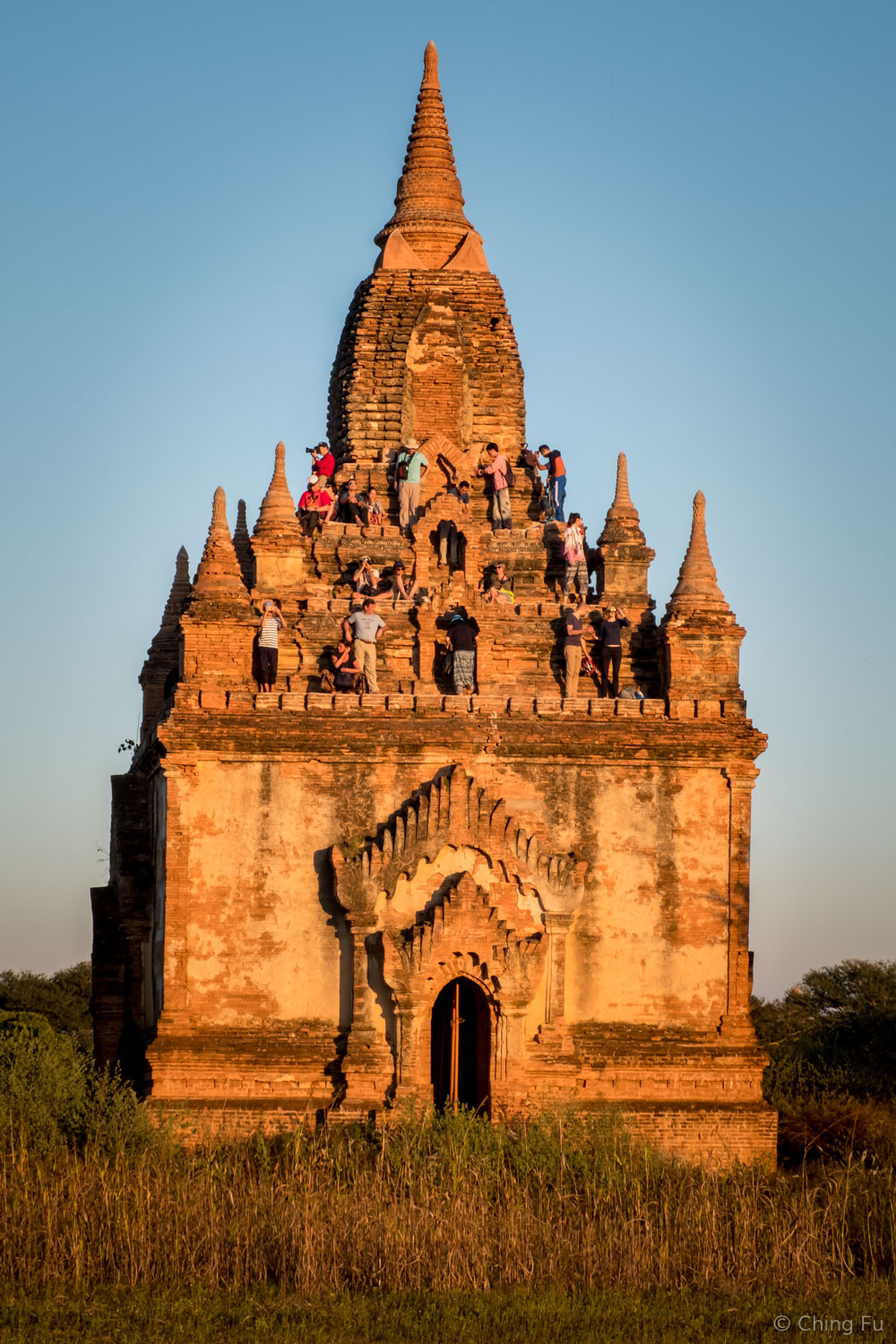 Travelers on temple platforms to watch the sunset.