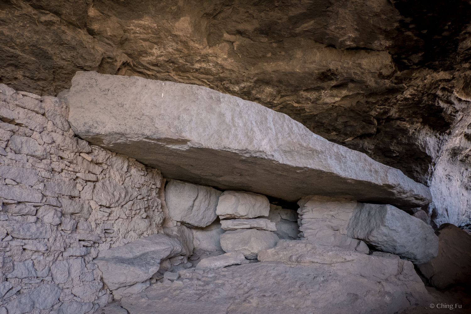 This large rock most likely fell down while the Mogollon people were living in the cave. It landed on a smaller rock that was used to grind food.