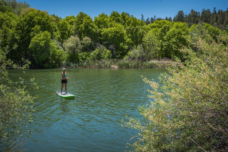 Ching paddleboarding Lake Roberts.