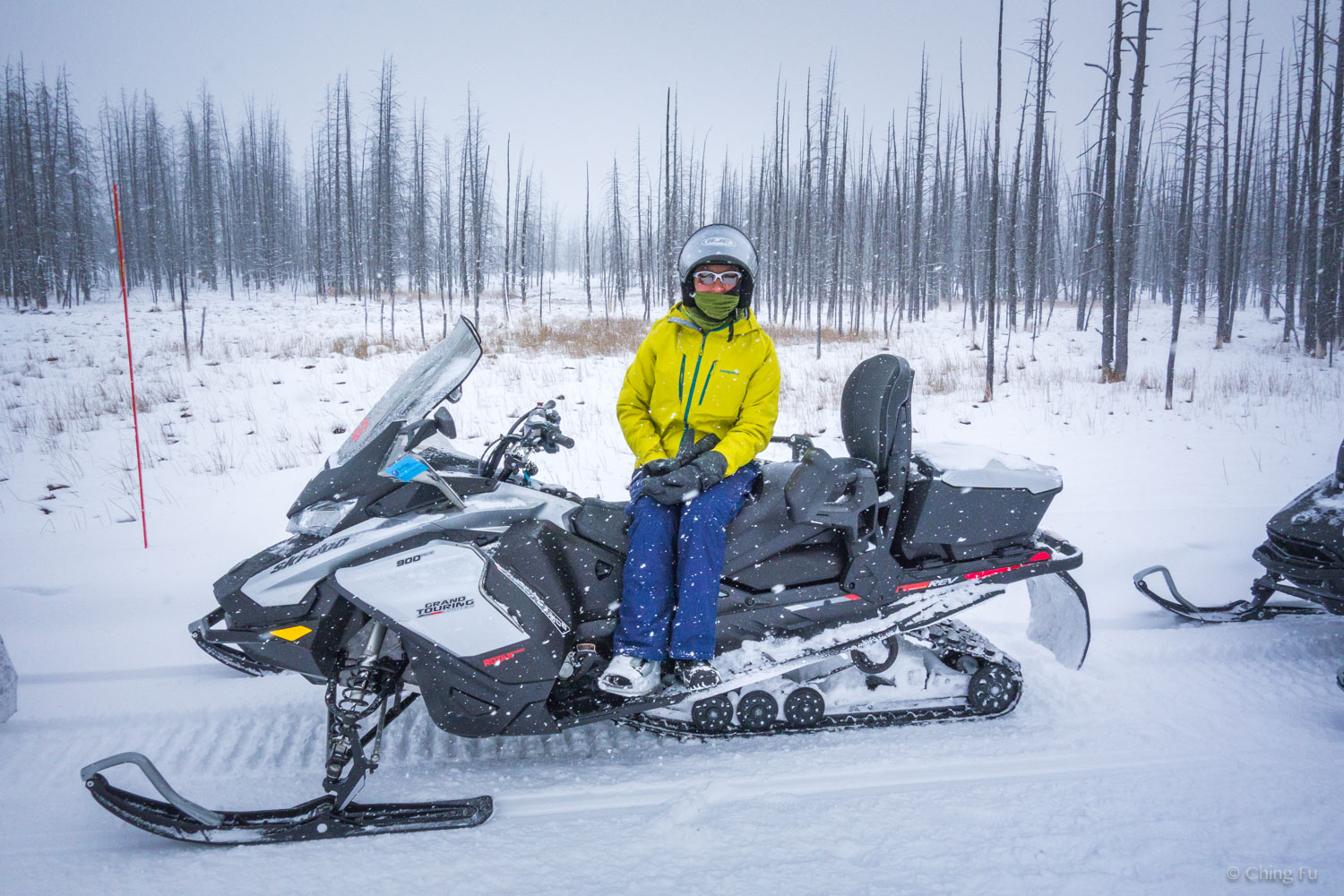 Ching on a snowmobile at Yellowstone National Park.