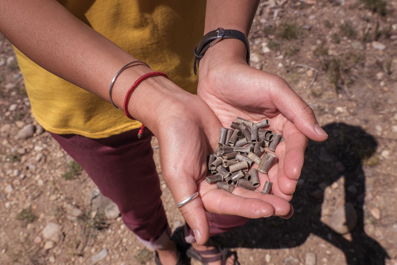Salvaged bullet casing for Viridian Range earrings.