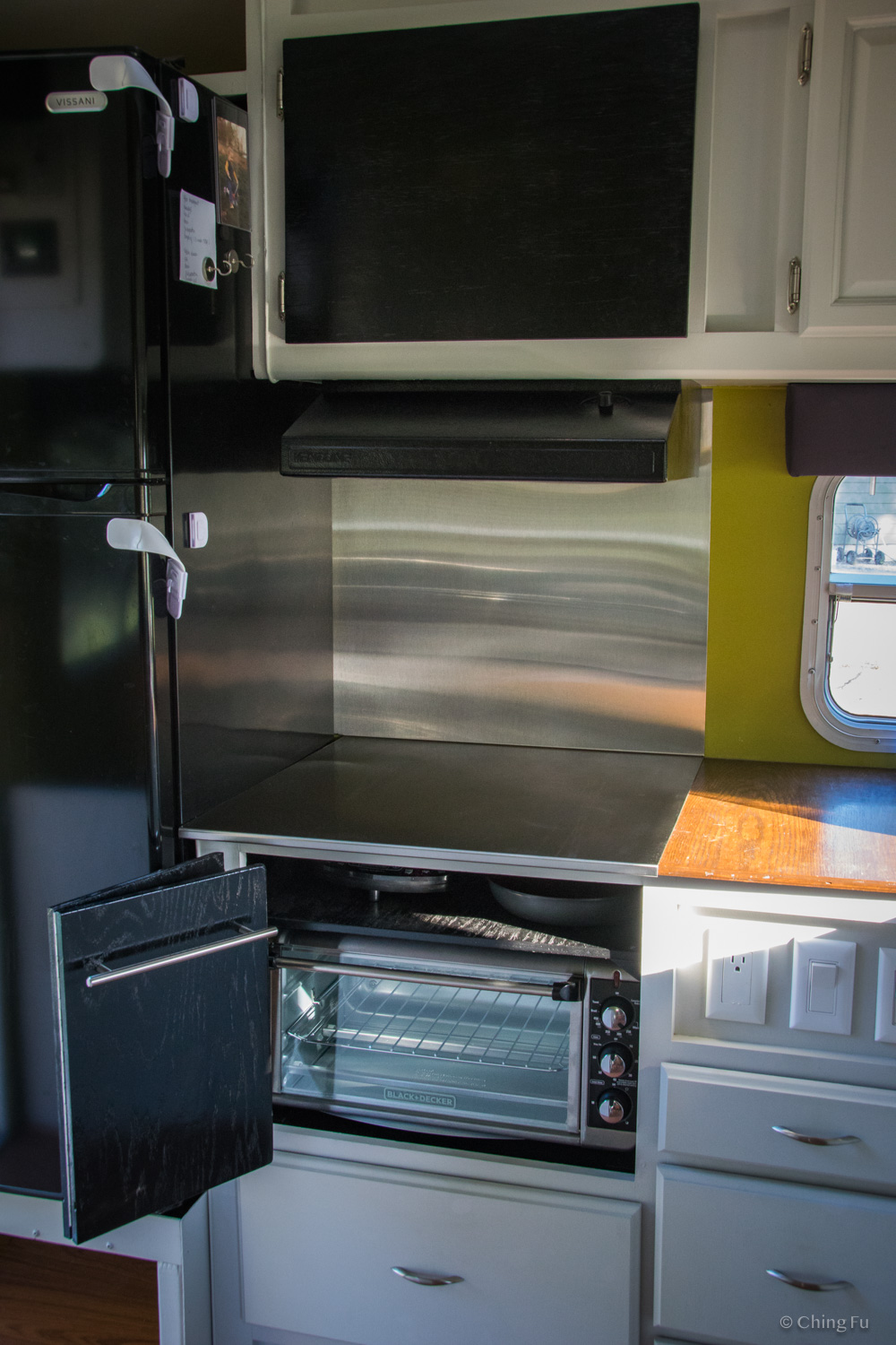 Part of our kitchen. Our induction cooktop is stored above the toaster oven.