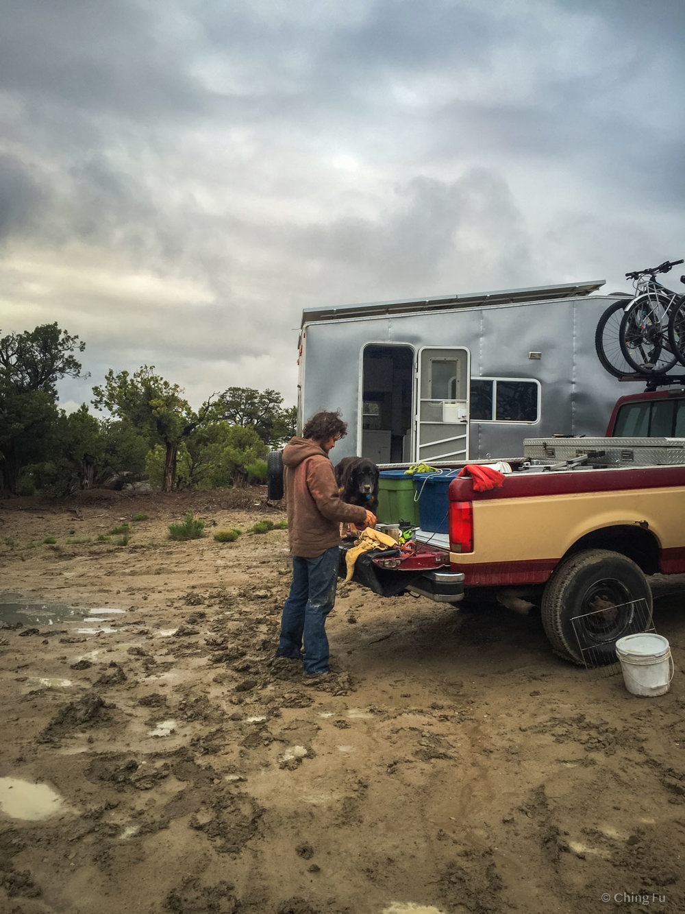 It rained hard on us while we were boondocked in Colorado in late spring (aka mud season). The dogs were covered in mud after our walks and we had to wash their feet off on the tailgate and then carry them into the Toaster. We learned our lesson after this incident.