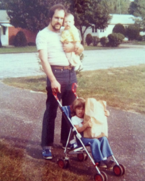 Dad, what a hipster. :) My sister Janet is in the stroller. Dad is holding me.