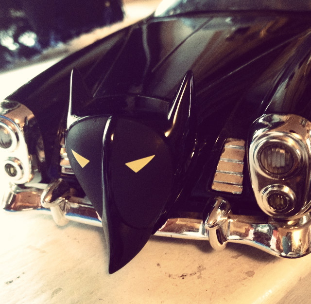 Holy mobiles Batman! How about this awesome metal replica vintage Batmobile. It even has Batmans science equipment (microscope etc) in the back of the car! Zoom Zoom!