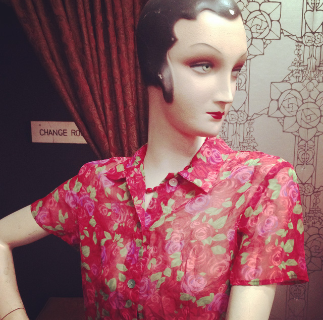 This colourful vintage floral blouse looks great with this purple glass pendant..