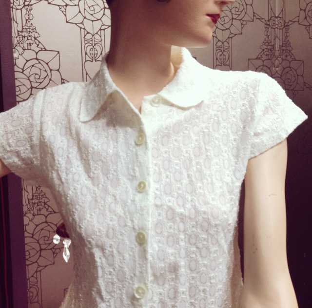 Light lace blouse becomes even lovelier paired with the pretty pink flower pendant below.