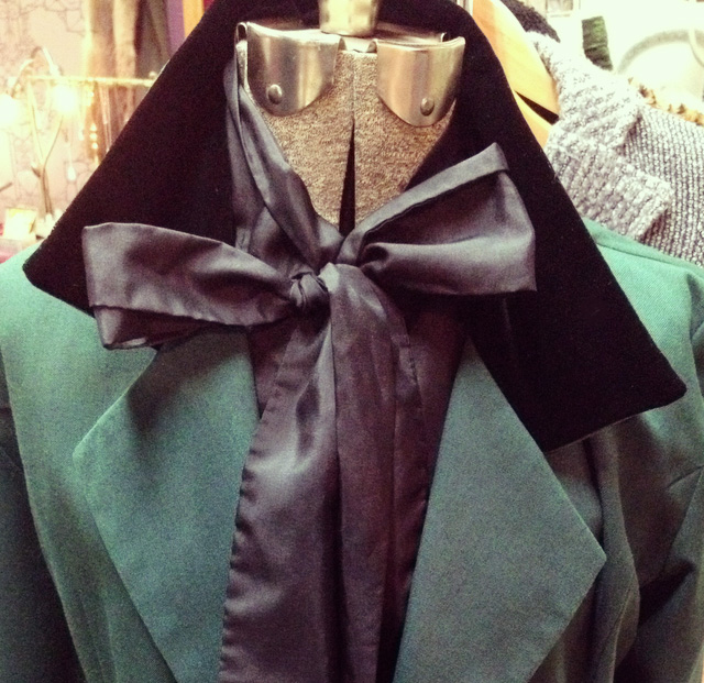 Green riding jacket with velvet collar and buttons, vintage  Le Chateau, made in Canada.