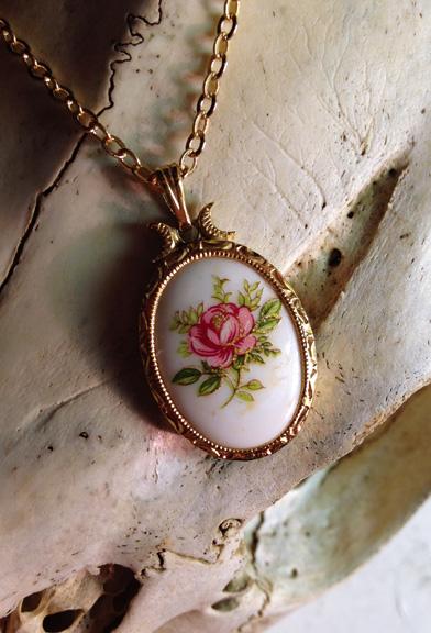 Pretty pink flower pendant .