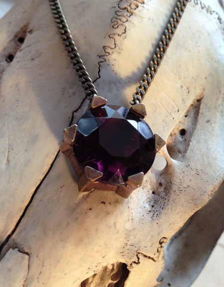 Reincarnated victorian glass pendant set in a unique base.