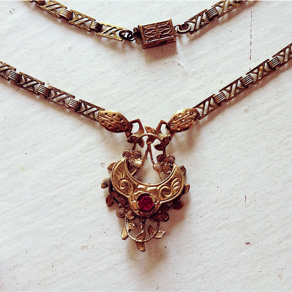 I assembled this pendant out of reincarnated Victorian bits and pieces of book chain.