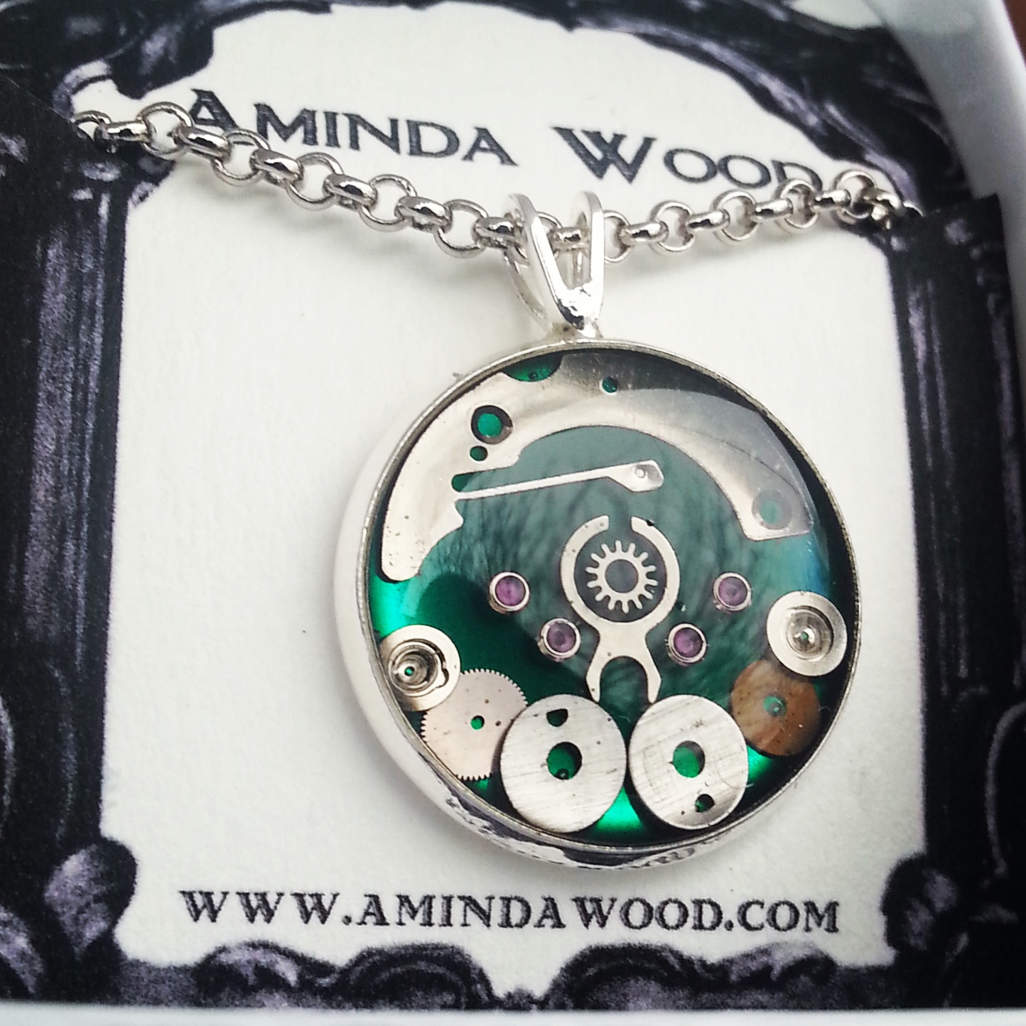 These are my newest style pendants and they measure only 2.5cm in diameter! Each one contains a unique collage of watch parts.