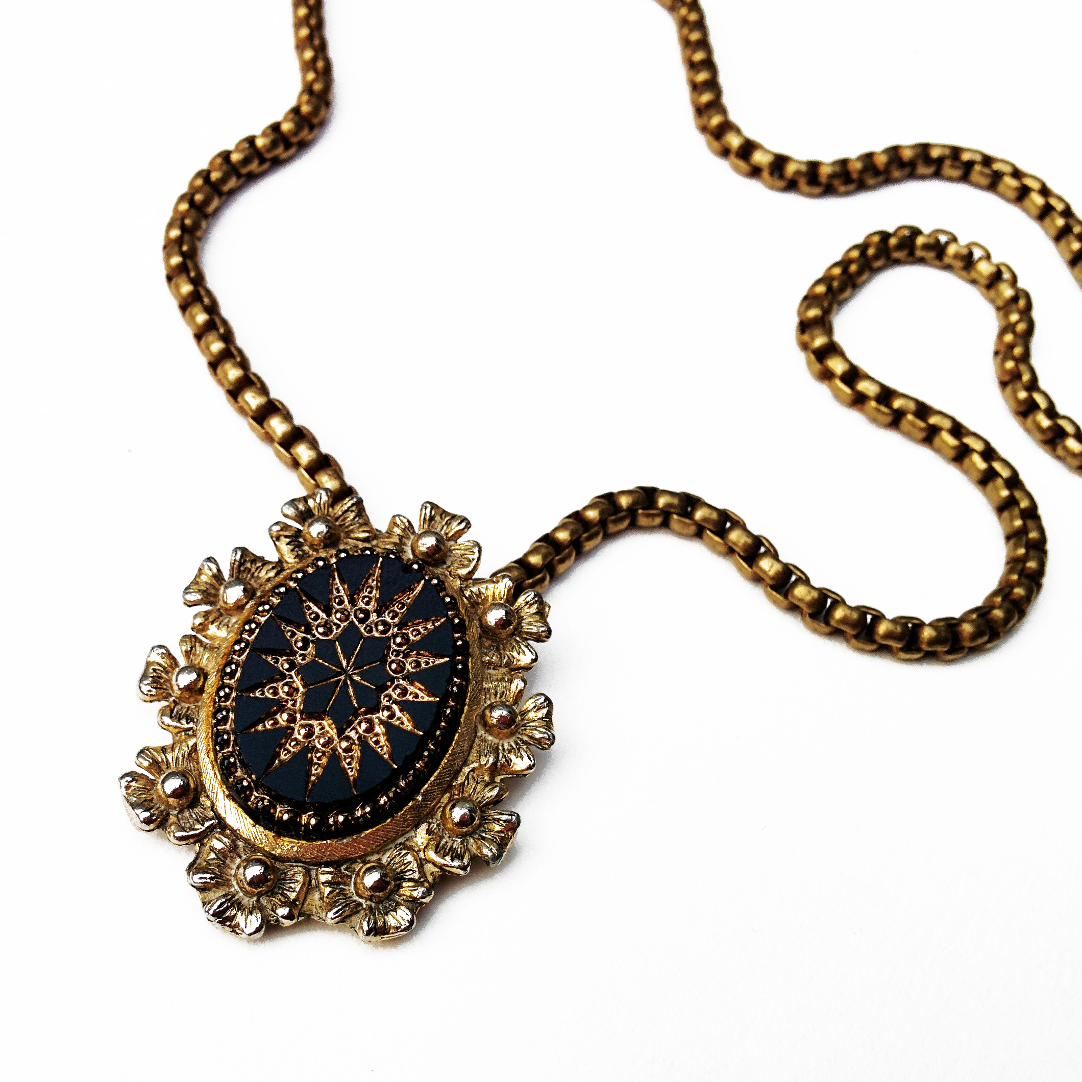 Beautiful Victorian inspired piece made using an antique scarf clip.