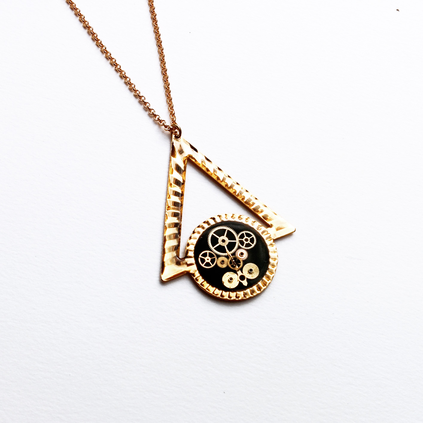 One of a kind watch part pendant made from an up cycled single earring.