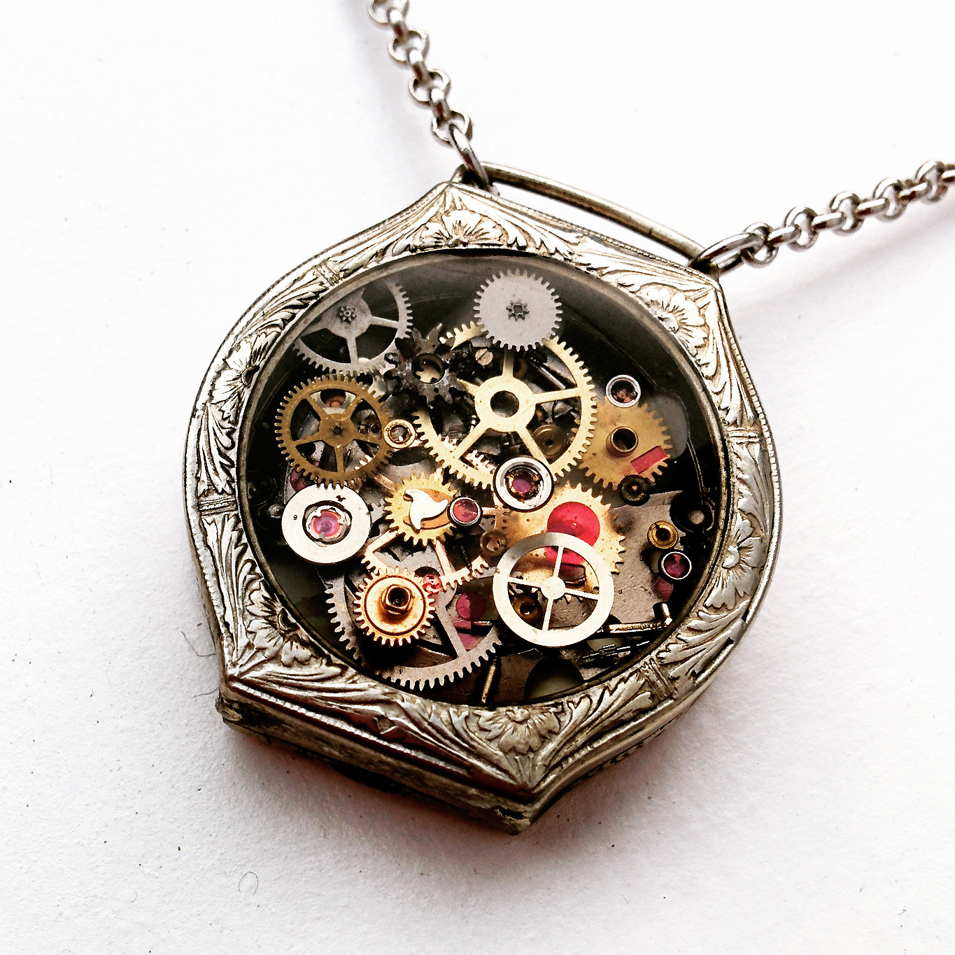 A true one of a kind piece! This antique watch case has 7layers of authentic disassembled watch parts <3