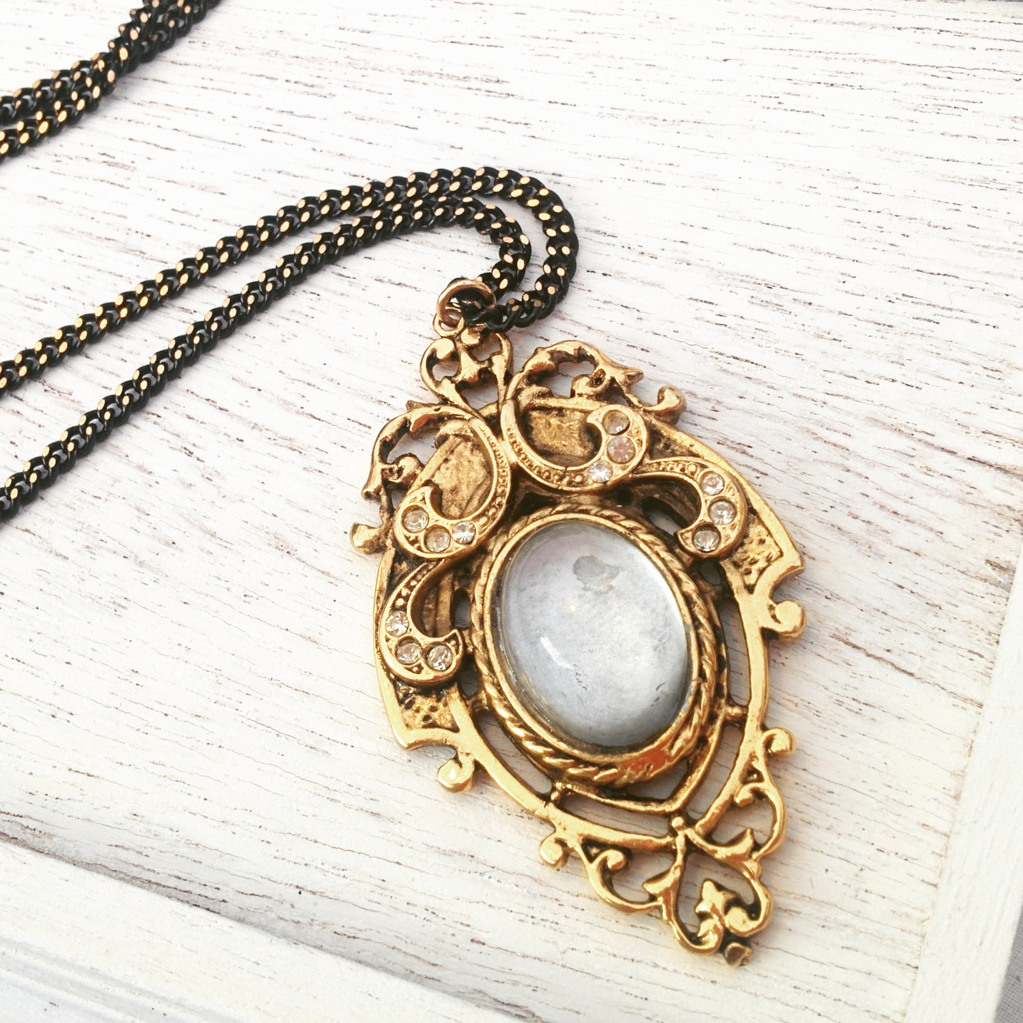The pendant to end all pendants! This incredibly detailed beauty was removed from a vintage brooch and converted to this beautiful golden black chain. This one almost didn't make it out of the studio, i'm in love with it!